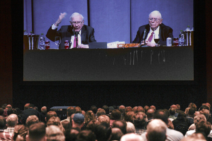 Shareholders in overflow rooms watch on a big screen as Berkshire Hathaway Chairman and CEO Warren Buffett, left, and Vice Chairman Charlie Munger preside over the annual Berkshire Hathaway shareholders meeting in Omaha, Neb., Saturday, May 4, 2019. An estimated 40,000 people are thought to be in town for the event, where Buffett and Munger spend hours answering questions. (AP Photo/Nati Harnik)