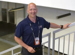 """FILE - In this June 6, 2015, file photo, Columbus Blue Jackets general manager Jarmo Kekalainen poses for a photo as he watches NHL draft prospects test during the NHL Combine in Buffalo, N.Y. Kekalainen sees the overhaul of the Blue Jackets not as a rebuilding but """"an opportunity to reload."""" (AP Photo/Gary Wiepert, File)"""