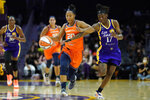 Los Angeles Sparks guard Erica Wheeler (17) fouls Connecticut Sun guard Briann January (20) during the first half of WNBA basketball game Thursday, Sept. 9, 2021, in Los Angeles. (AP Photo/Ashley Landis)