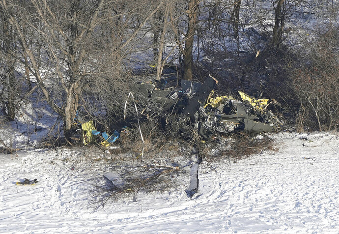 FILE - This Friday, Dec. 6, 2019, file aerial photo shows the crash site of a Minnesota National Guard Black Hawk helicopter,  near Kimball, Minn. The Minnesota National Guard says mechanical failure and human error led to the crash that killed three Guard members. (Brian Peterson/Star Tribune via AP, File)