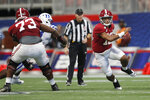 Alabama quarterback Tua Tagovailoa (13) scrambles during the first half of an NCAA college football game against Duke, Saturday, Aug. 31, 2019, in Atlanta. (AP Photo/John Bazemore)