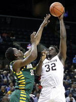 St. Bonaventure's Amadi Ikpeze (32) shoots over George Mason's Ian Boyd (32) during the first half of an NCAA college basketball game in the Atlantic 10 conference tournament Friday, March 15, 2019, in New York. (AP Photo/Frank Franklin II)