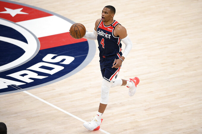 Washington Wizards guard Russell Westbrook brings the ball up during the first half of the team's NBA basketball game against the Cleveland Cavaliers, Friday, May 14, 2021, in Washington. (AP Photo/Nick Wass)