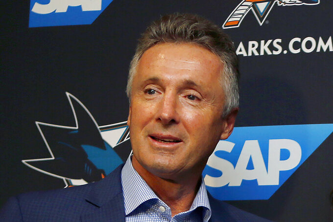 """FILE - In this Sept. 19, 2018, file photo, San Jose Sharks general manager Doug Wilson attends a news conference in San Jose, Calif. Wilson characterized his team as being in the middle of a """"reset"""" where taking a step back may be necessary before the franchise can get back into contention after years near the top of the standings. (AP Photo/Josie Lepe, File)"""