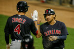 Cleveland Indians' Josh Naylor, right, celebrates with Bradley Zimmer (4) after hitting a solo home run against the Minnesota Twins in the ninth inning of a baseball game Friday, June 25, 2021, in Minneapolis. (AP Photo/Bruce Kluckhohn)