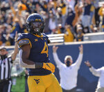 West Virginia running back Leddie Brown (4) scores a touchdown against Kansas during an NCAA college football game, Saturday, Oct. 17, 2020, in Morgantown, W.Va. (William Wotring/The Dominion-Post via AP)