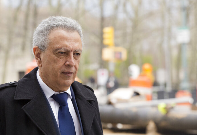 FILE - In this April 11, 2016, file photo, former FIFA vice president Alfredo Hawit leaves federal court in the Brooklyn borough of New York. Hawit, the former president of soccer's governing body for North and Central American and the Caribbean, has been sentenced to time served for his role in accepting $1.66 million in bribes in the FIFA scandals and will return to Honduras after 4 1/2 years in the U.S. (AP Photo/Mark Lennihan, File)