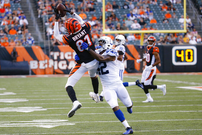 Cincinnati Bengals wide receiver Ventell Bryant (81) makes a catch over Indianapolis Colts defensive back Rolan Milligan (42) during the first half of an NFL preseason football game Thursday, Aug. 29, 2019, in Cincinnati. (AP Photo/Frank Victores)
