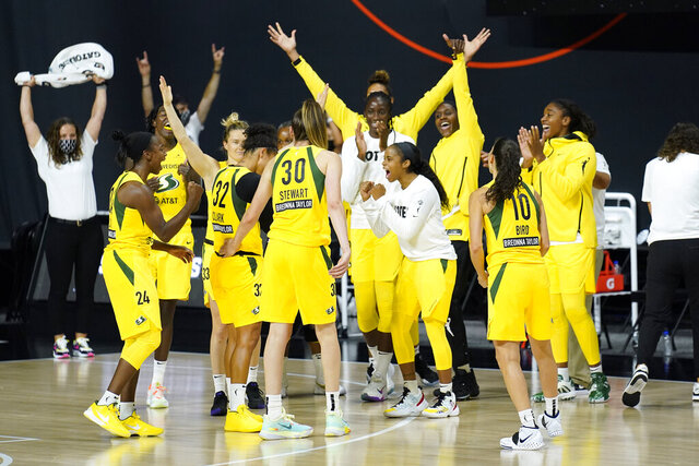 The Seattle Storm celebrate their win over Minnesota Lynx during the second half of Game 1 of a WNBA basketball semifinal round playoff series Tuesday, Sept. 22, 2020, in Bradenton, Fla. (AP Photo/Chris O'Meara)