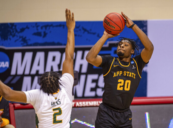 Appalachian State guard Adrian Delph (20) shoots a three-point basket during the first half of a First Four game against Norfolk State in the NCAA men's college basketball tournament, Thursday, March 18, 2021, in Bloomington, Ind. (AP Photo/Doug McSchooler)