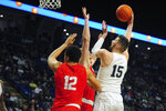 Penn State's Trent Buttrick (15) puts up a one handed shot around Cornell's Kobe Dickson (12) during first half action of an NCAA college basketball game, Sunday, Dec. 29, 2019, in State College, Pa. (AP Photo/Gary M. Baranec)