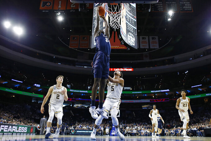 Georgetown's Qudus Wahab, left, goes up for a dunk against Villanova's Justin Moore during the first half of an NCAA college basketball game, Saturday, Jan. 11, 2020, in Philadelphia. (AP Photo/Matt Slocum)