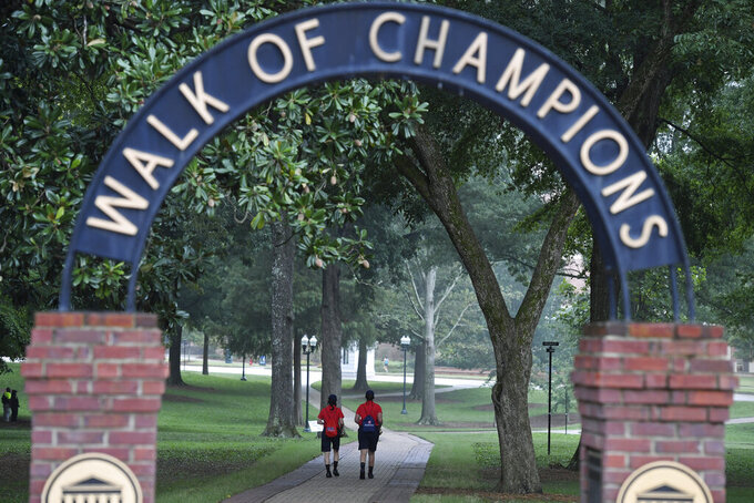 Members of the Mississippi Pride of the South band walk through the Grove before an NCAA college football game between Mississippi and Florida in Oxford, Miss., Saturday, Sept. 26, 2020. (AP Photo/Thomas Graning)