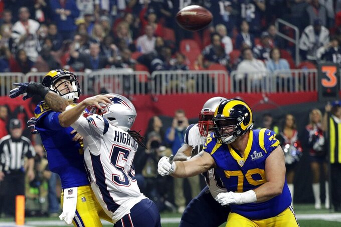 New England Patriots' Dont'a Hightower (54) hits Los Angeles Rams' Jared Goff, left, as he throws a pass during the second half of the NFL Super Bowl 53 football game Sunday, Feb. 3, 2019, in Atlanta. (AP Photo/David J. Phillip)