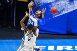 UCLA's Johnny Juzang (3) and Michigan State's Rocket Watts (2) compete for a rebound during the first half of a First Four game in the NCAA men's college basketball tournament Thursday, March 18, 2021, at Mackey Arena in West Lafayette, Ind. (AP Photo/Robert Franklin)