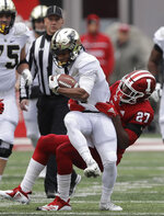 Purdue's Rondale Moore (4) is tackled by Indiana's Devon Matthews (27) during the first half of an NCAA college football game, Saturday, Nov. 24, 2018, in Bloomington, Ind. (AP Photo/Darron Cummings)