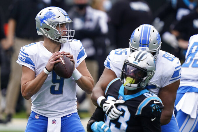 Detroit Lions quarterback Matthew Stafford looks to pass against the Carolina Panthers during the first half of an NFL football game Sunday, Nov. 22, 2020, in Charlotte, N.C. (AP Photo/Gerry Broome)
