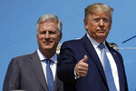 President Donald Trump and Robert O'Brien, just named as the new national security adviser, board Air Force One at Los Angeles International Airport, Wednesday, Sept. 18, 2019, in Los Angeles. (AP Photo/Evan Vucci)