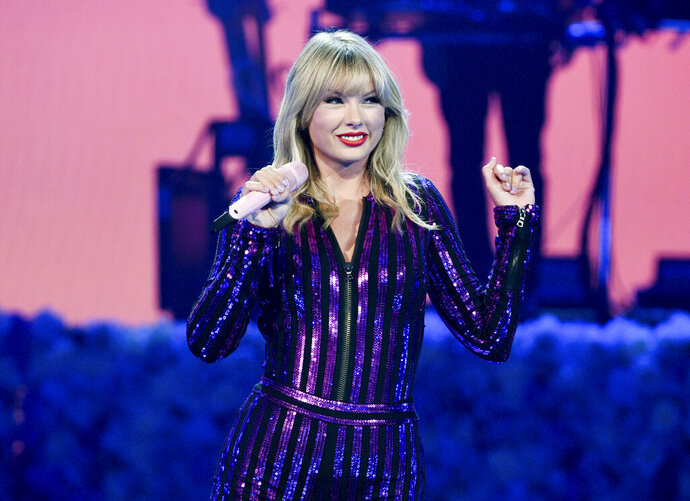 FILE - In this July 10, 2019 file photo Taylor Swift performs at Amazon Music's Prime Day concert in New York. Swift will be honored with the award for artist of the decade at this year's American Music Awards. (Photo by Evan Agostini/Invision/AP, File)