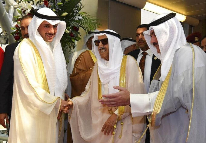 FILE - In this Wednesday, Oct. 16, 2019 file photo released by Kuwait News Agency, KUNA, Emir of Kuwait Sheikh Sabah al-Ahmad al-Sabah, middle, receives by Kuwaiti officials after his arrival from the U.S. in Kuwait. Kuwait state television said Tuesday, Sept. 29, 2020, the country's 91-year-old ruler, Sheikh Sabah Al Ahmad Al Sabah, had died. ( KUNA via AP, File)