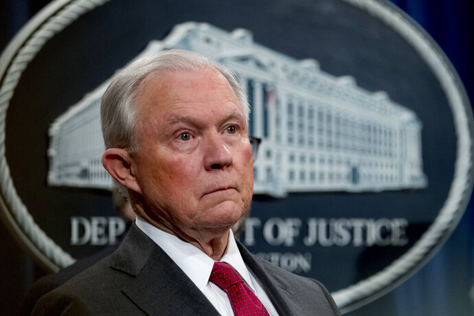 FILE - In this Oct. 16, 2018 file photo, then Attorney General Jeff Sessions attends a news conference at the Justice Department in Washington. The Justice Department is honoring former Attorney General Jeff Sessions as Washington awaits word from special counsel Robert Mueller.  (AP Photo/Andrew Harnik)