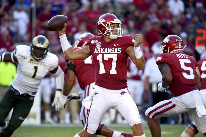 Arkansas quarterback Nick Starkel throws a pass against Colorado State during the second half of an NCAA college football game Saturday, Sept. 14, 2019, in Fayetteville, Ark. (AP Photo/Michael Woods)