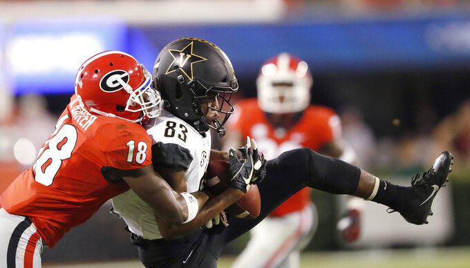 Georgia defensive back Deandre Baker (18) breaks up a pass intended for Vanderbilt wide receiver C.J. Bolar (83) during the first half of an NCAA college football game Saturday, Oct. 6, 2018, in Atlanta. (AP Photo/John Bazemore)