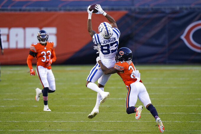 Indianapolis Colts' Marcus Johnson (83) makes a catch against Chicago Bears' Buster Skrine (24) during the second half of an NFL football game, Sunday, Oct. 4, 2020, in Chicago. (AP Photo/Nam Y. Huh)