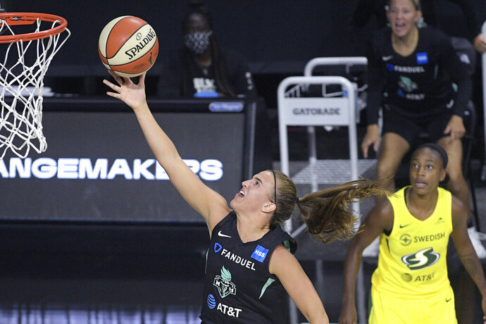 New York Liberty forward Sabrina Ionescu goes up for a shot as Seattle Storm guard Jewell Loyd, right, watches during the second half of a WNBA basketball game, Saturday, July 25, 2020, in Ellenton, Fla. (AP Photo/Phelan M. Ebenhack)