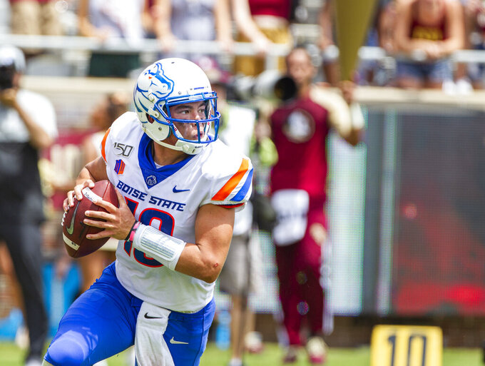 Boise State quarterback Hank Bachmeier (19) rolls out to pass in the first half of an NCAA college football game against Florida State in Tallahassee, Fla., Saturday, Aug. 31, 2019. (AP Photo/Mark Wallheiser)