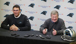 Carolina Panthers head coach Ron Rivera, left, and general manager Marty Hurney, right, share a laugh as they speak to the media in Charlotte, N.C., Wednesday, April 17, 2019, in advance of the NFL draft. (AP Photo/Chuck Burton)