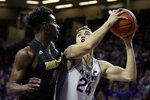 Kansas State's Pierson McAtee (24) shoots under pressure from Alabama State's Brandon Battle during the first half of an NCAA college basketball game Wednesday, Dec. 11, 2019, in Manhattan, Kan. (AP Photo/Charlie Riedel)