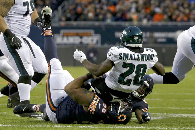 Chicago Bears defensive end Akiem Hicks (96) tackles Philadelphia Eagles running back Wendell Smallwood (28) during the first half of an NFL wild-card playoff football game Sunday, Jan. 6, 2019, in Chicago. (AP Photo/David Banks)