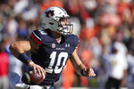 Auburn quarterback Bo Nix (10) scrambles as he looks to throw a pass against Georgia State during the first half of an NCAA college football game Saturday, Sept. 25, 2021, in Auburn, Ala. (AP Photo/Butch Dill)