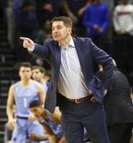 Columbia head coach Jim Engles calls a play during an NCAA college basketball game against Virginia in Charlottesville, Va., Saturday, Nov. 16, 2019. (AP Photo/Andrew Shurtleff)