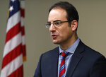 Colorado Attorney General Phil Weiser speaks about the plan to have a former federal prosecutor review the sexual abuse files of Colorado's Roman Catholic dioceses at a news conference Tuesday, Feb. 19, 2019, in Denver. The church will pay reparations to victims under a voluntary joint effort with the state attorney general. (AP Photo/David Zalubowski)