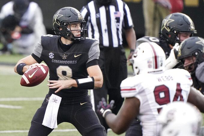 Vanderbilt quarterback Ken Seals (8) passes against South Carolina in the second half of an NCAA college football game Saturday, Oct. 10, 2020, in Nashville, Tenn. South Carolina won 41-7. (AP Photo/Mark Humphrey)
