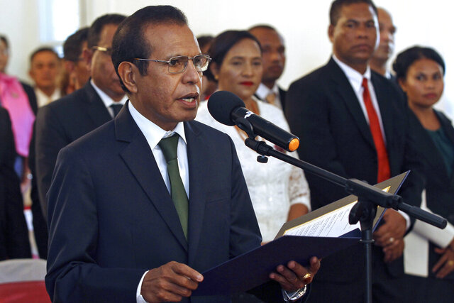 FILE - In this June 22, 2018, file photo, East Timorese Prime Minister Taur Matan Ruak reads out the oath of office during his inauguration in Dili, the capital of East Timor. The prime minister offered his resignation Tuesday, Feb. 25, 2020, after the budget failed to pass in Parliament. (AP Photo/Kandhi Barnez, File)