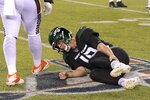 New York Jets quarterback Trevor Siemian (19) grabs his leg after being hurt during the first half of an NFL football game against the Cleveland Browns, Monday, Sept. 16, 2019, in East Rutherford, N.J. (AP Photo/Bill Kostroun)