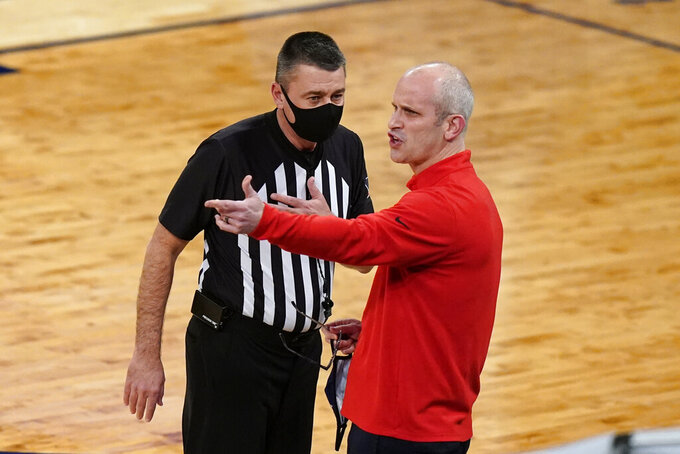 Connecticut coach Dan Hurley argues a call with an official during the first half of the team's NCAA college basketball game against Creighton in the semifinals in the Big East men's tournament Friday, March 12, 2021, in New York. (AP Photo/Frank Franklin II)