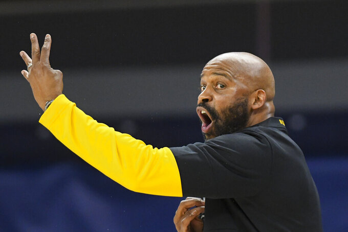 Missouri coach Cuonzo Martin talks to the team from the sideline during the first half of an NCAA college basketball game against Auburn on Tuesday, Jan. 26, 2021, in Auburn, Ala. (AP Photo/Julie Bennett)