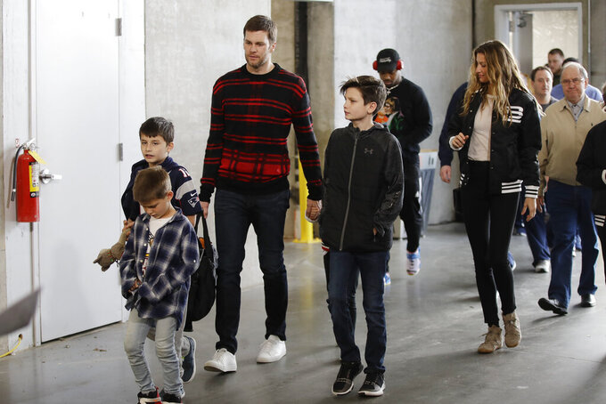 New England Patriots quarterback Tom Brady, his wife Gisele Bundchen, and their family arrive for a NFL football walkthrough, Saturday, Feb. 2, 2019, in Atlanta, ahead of Super Bowl 53 against the Los Angeles Rams. (AP Photo/Matt Rourke)