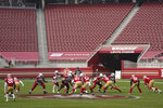 Empty seats at Levi's Stadium are shown as Arizona Cardinals quarterback Kyler Murray (1) takes the snap against the San Francisco 49ers during the second half of an NFL football game in Santa Clara, Calif., Sunday, Sept. 13, 2020. (AP Photo/Tony Avelar)