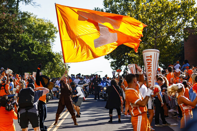 Tennessee's Davy Crockett mascot waves a flag during the Vol Walk before an NCAA college football game against Bowling Green Thursday, Sept. 2, 2021, in Knoxville, Tenn. (AP Photo/Wade Payne)