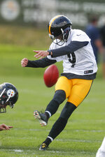Pittsburgh Steelers kicker Chris Boswell (9) hits a place kick during an NFL football training camp practice in Latrobe, Pa., Friday, July 26, 2019. (AP Photo/Keith Srakocic)