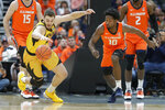 Missouri's Reed Nikko, left, and Illinois' Andres Feliz (10) chase a loose ball during the first half of an NCAA college basketball game Saturday, Dec. 21, 2019, in St. Louis. (AP Photo/Jeff Roberson)