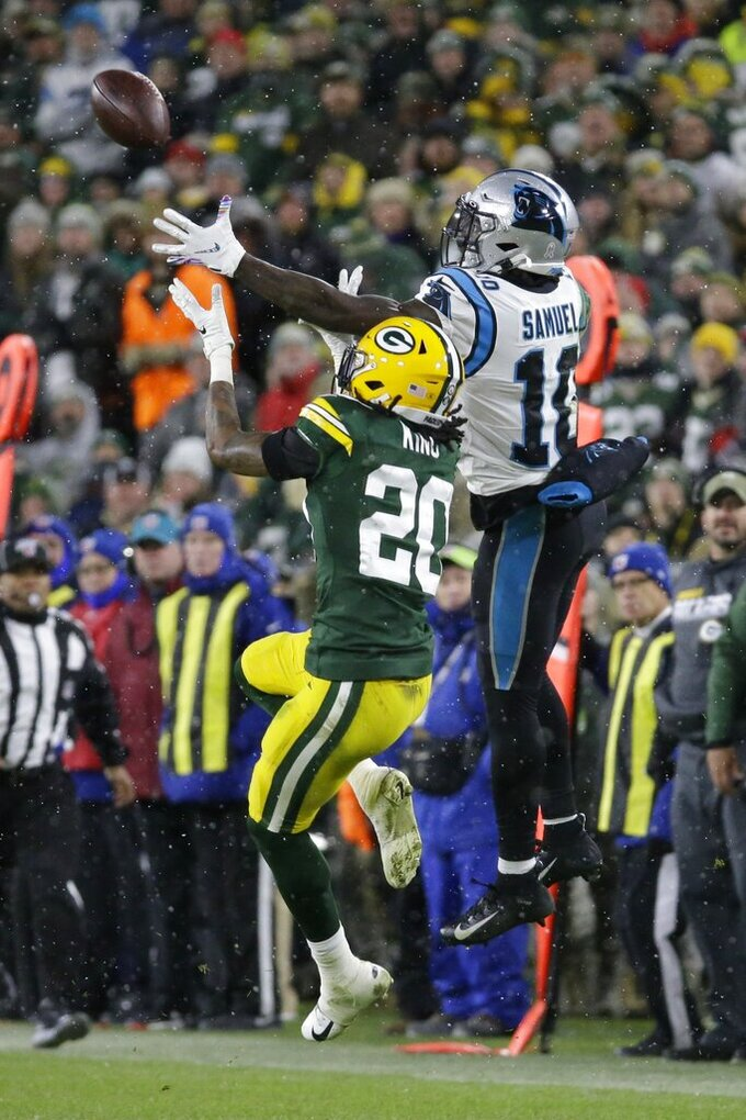 Green Bay Packers' Kevin King breaks up a pass intended for Carolina Panthers' Curtis Samuel during the second half of an NFL football game Sunday, Nov. 10, 2019, in Green Bay, Wis. (AP Photo/Mike Roemer)