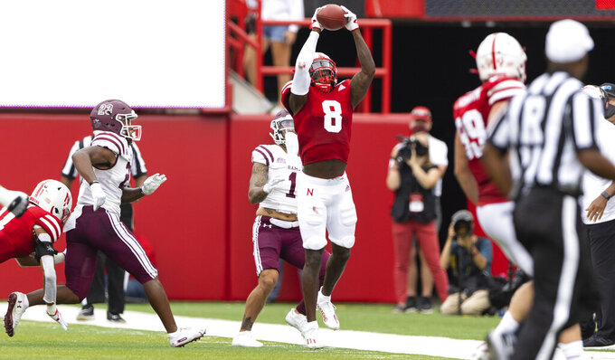 Nebraska's Deontai Williams (8) intercepts a pass intended for Fordham's Hamze El-Zayat (1) during the second half of an NCAA college football game Saturday, Sept. 4, 2021, at Memorial Stadium in Lincoln, Neb. (AP Photo/Rebecca S. Gratz)