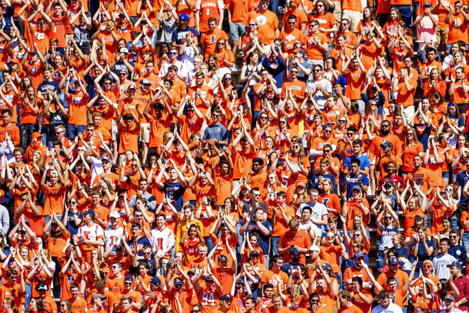 FILE - In this Sept. 2, 2017, file photo, the Illinois student section cheers during a home opener NCAA college football game against Ball State, at Memorial Stadium in Champaign, Ill.  When Illinois opens its season at home Saturday against Kent State, a streak will be broken no matter the outcome. Illinois is coming off a 10-game losing streak and hopes to take advantage of a moribund Kent State team picked to finish last in its conference to extend a 20-game home-opener win streak. (AP Photo/Bradley Leeb, File)
