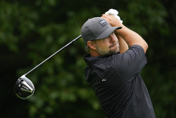 Ryan Moore hits off the second tee during the final round of the John Deere Classic golf tournament, Sunday, July 11, 2021, at TPC Deere Run in Silvis, Ill. (AP Photo/Charlie Neibergall)